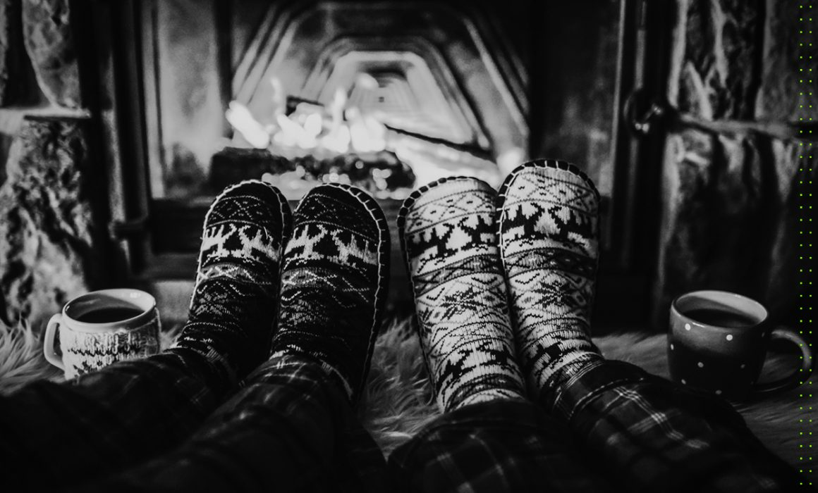 Couple slippers by a fire